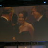 Anna and William meet Prince Charles (video screen)