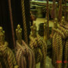 Rigging tied onto carved statues
